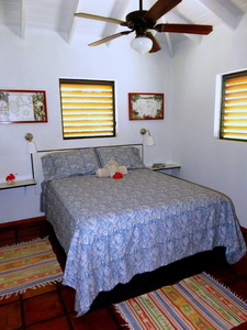 Comfortable queen bed at Harbour Club Villas vacation villa rental on Provo Turks and Caicos Islands